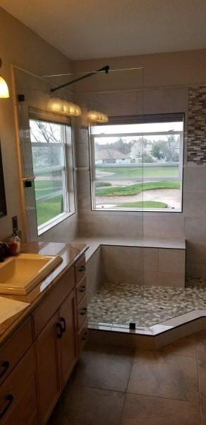 Bathroom remodeling with corner frameless door
