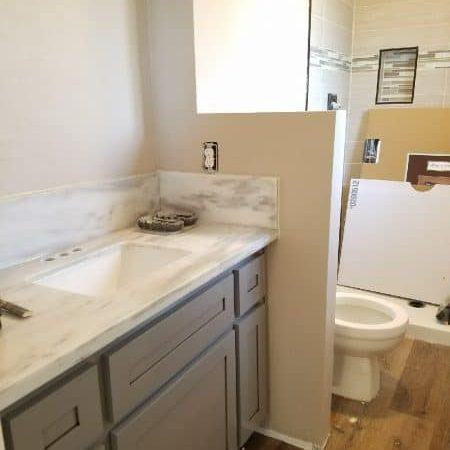 Remodeling a bathroom with a dividing wall to create privacy