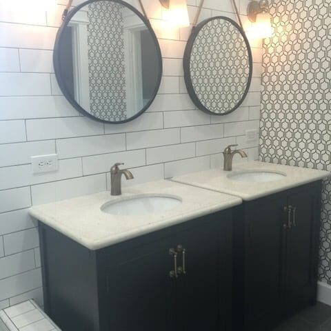 Bathroom remodel with round mirrors