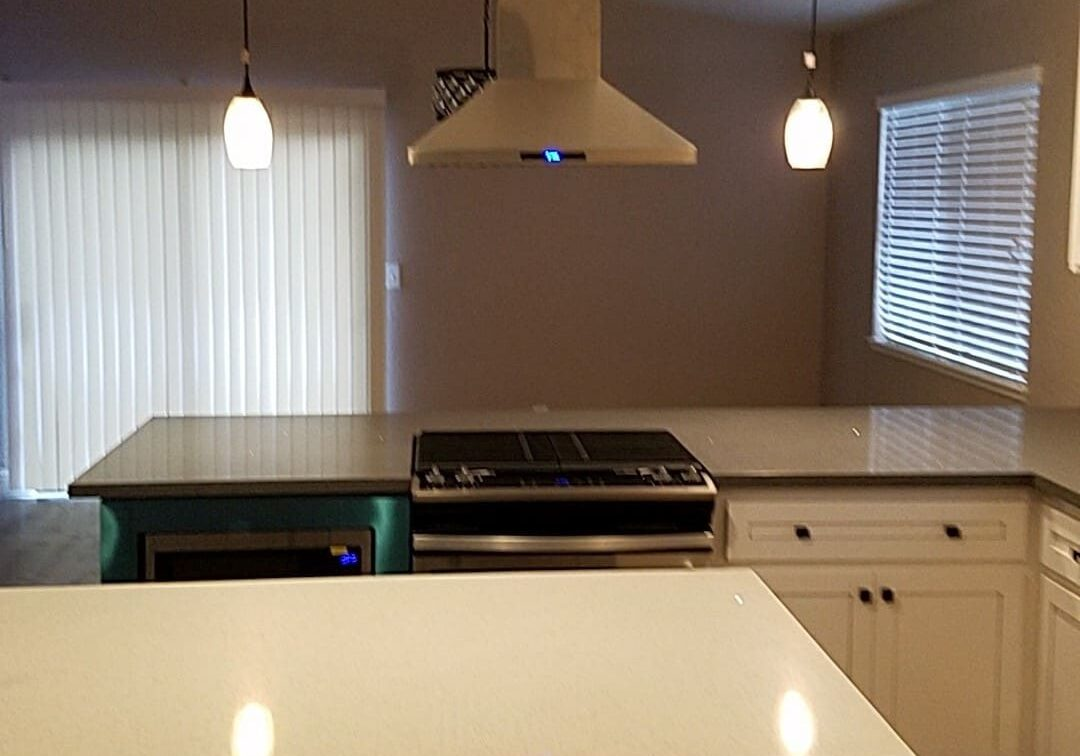 Kitchen Remodeling Contractor shows new Stove Hood